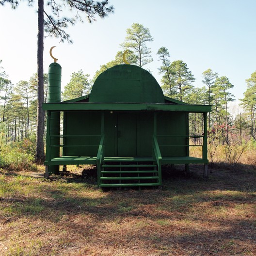 """Christopher Sims, Green Mosque, Camp Mackall, North Carolina, 2006. Courtesy of the artist. From the 2017 Individual Grant to Christopher Sims for """"Theater of War: The Pretend Villages of Iraq and Afghanistan."""". Image Courtesy of Graham Foundation"""