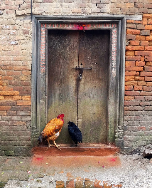 """""""There is a tradition of offering prayers at the door every morning. The two red dots are the offerings to the 'Dwarpals' (security guards)"""". Image © Nipun Prabhakar"""