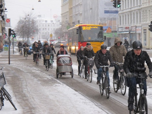 The cyclists commute to work in Copenhagen, snow or shine. Image © Kaitlin Johnson