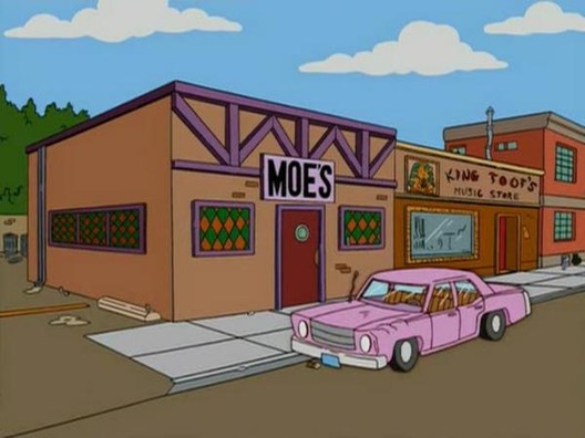 """Moe's Tavern"" from ""The Simpsons"". Image via ""The Simpsons"" / Fandom"
