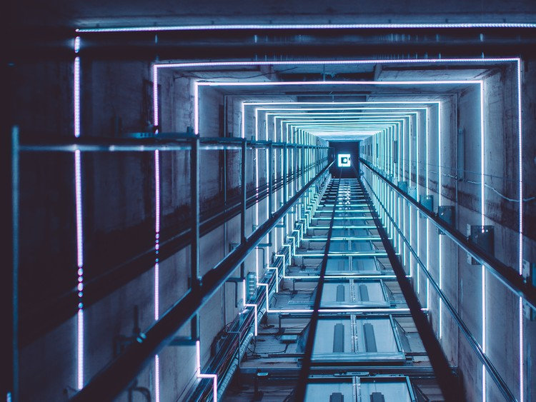 How New Technologies Are Turning Awkward Elevator Rides into a Thing of the Past, Lift with dynamic light show at the A'DAM Tower, Amsterdam. Designed by InventDesign, photography by Dennis Bouman. Image © InventDesign