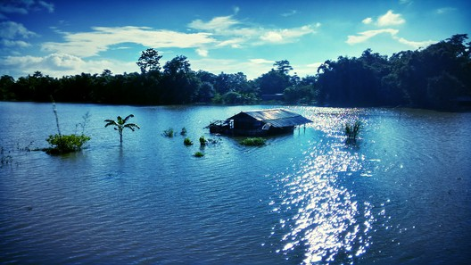 Floods in the North-eastern Indian state of Assam in 2005. Image © <a href='https://commons.wikimedia.org/wiki/File:Assam_flood_in_2015.jpg'>Wikimedia user Pradip Nemane</a> licensed under <a href='https://creativecommons.org/licenses/by-sa/4.0/deed.en'>CC BY-SA 4.0</a>