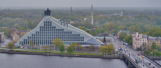 """The Latvian National Library (2014). © <a href=""""https://commons.wikimedia.org/wiki/File:Riga_Petrikirche_Blick_vom_Turm_zur_Nationalbibliothek.JPG"""">Wikimedia user Zairon</a> licensed under <a href=""""https://creativecommons.org/licenses/by-sa/4.0/"""">CC BY 4.0</a>. Image Courtesy of Zairon"""