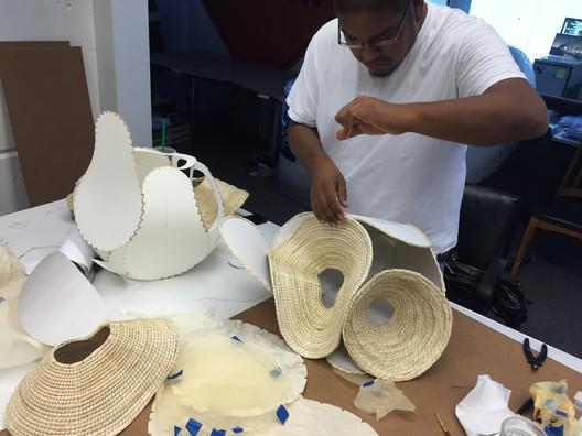 Terrol Dew Johnson weaving together panels of a basket. Image Courtesy of Aranda\Lasch
