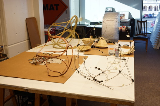 Baskets made of wire, copper, and bear grass in various stages of assembly. Image Courtesy of Aranda\Lasch