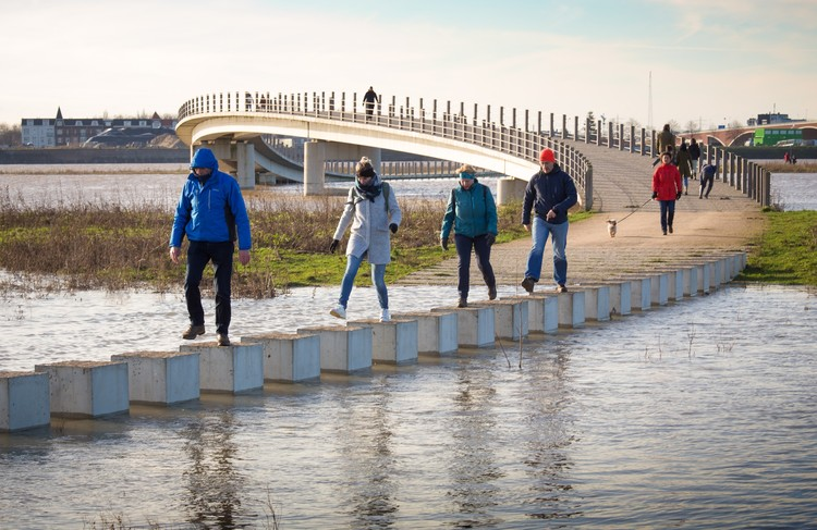 NEXT Architects' Zalige Bridge Transforms Into Stepping Stones During Flood Conditions, © NEXT Architects. Photography: Rutger Hollander