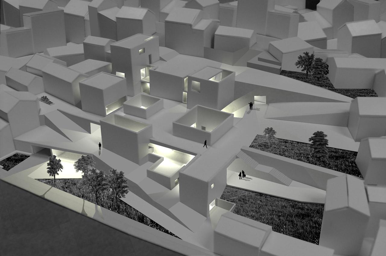 Prêmio Secil Universidades – Arquitetura: Mercado Multicultural na Cova da Moura / Ricardo Carreiro, Fotomontagem - Vista Áerea