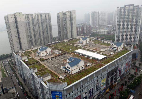 Casas construídas na cobertura de um shopping na China, Via Plataforma Urbana