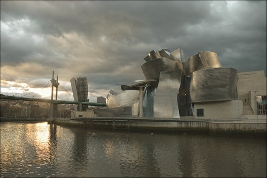 """Gehry's Guggenheim Museum in Bilbao inspired cities across Spain to get their own """"Guggenheim,"""" many of which now stand empty/unfinished in the light of the country's economic crisis. Photo via Flickr User CC Txanoduna"""