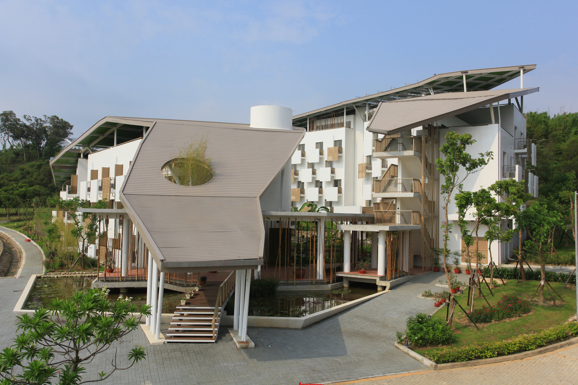 Gallery of dormitories for itri southern taiwan campus for Construction bio