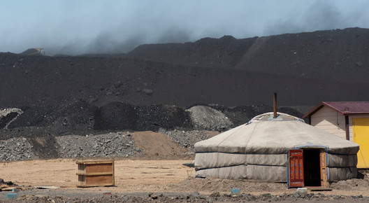 © Gilles Sabrie for The New York Times. Coal mounds in Gobi, Mongolia