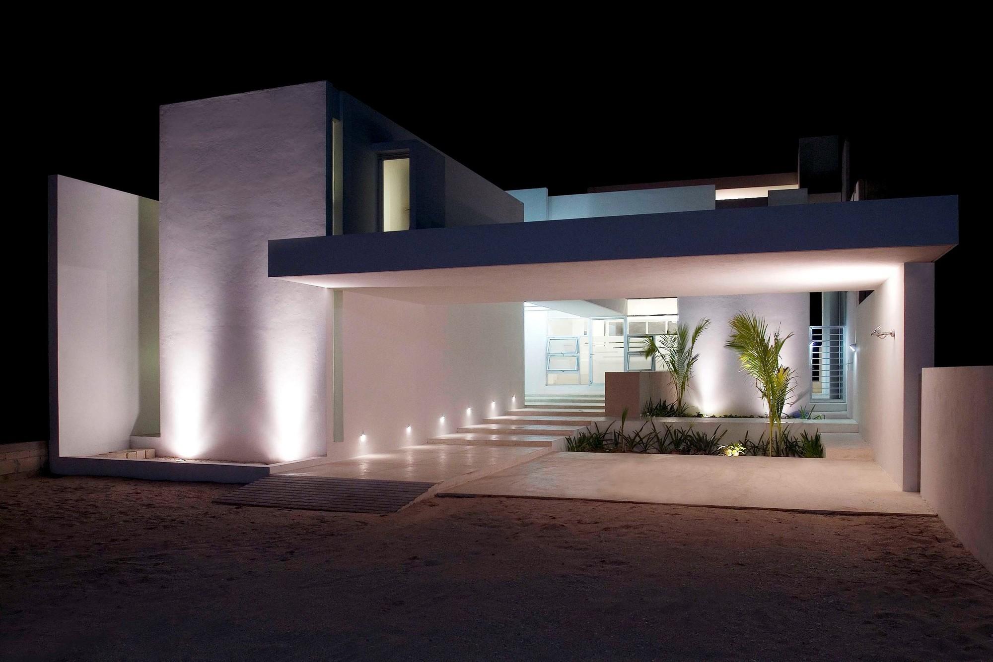 Galer a de casa escalonada seijo peon arquitectos 1 for Fachadas de casas con lamparas