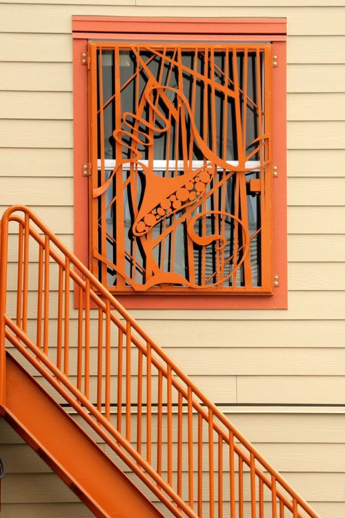 The YWCA Pierce County shelter, part of the Building Design project, uses artwork to mitigate the negative affect of security bars. Image courtesy of YWCA Pierce County.