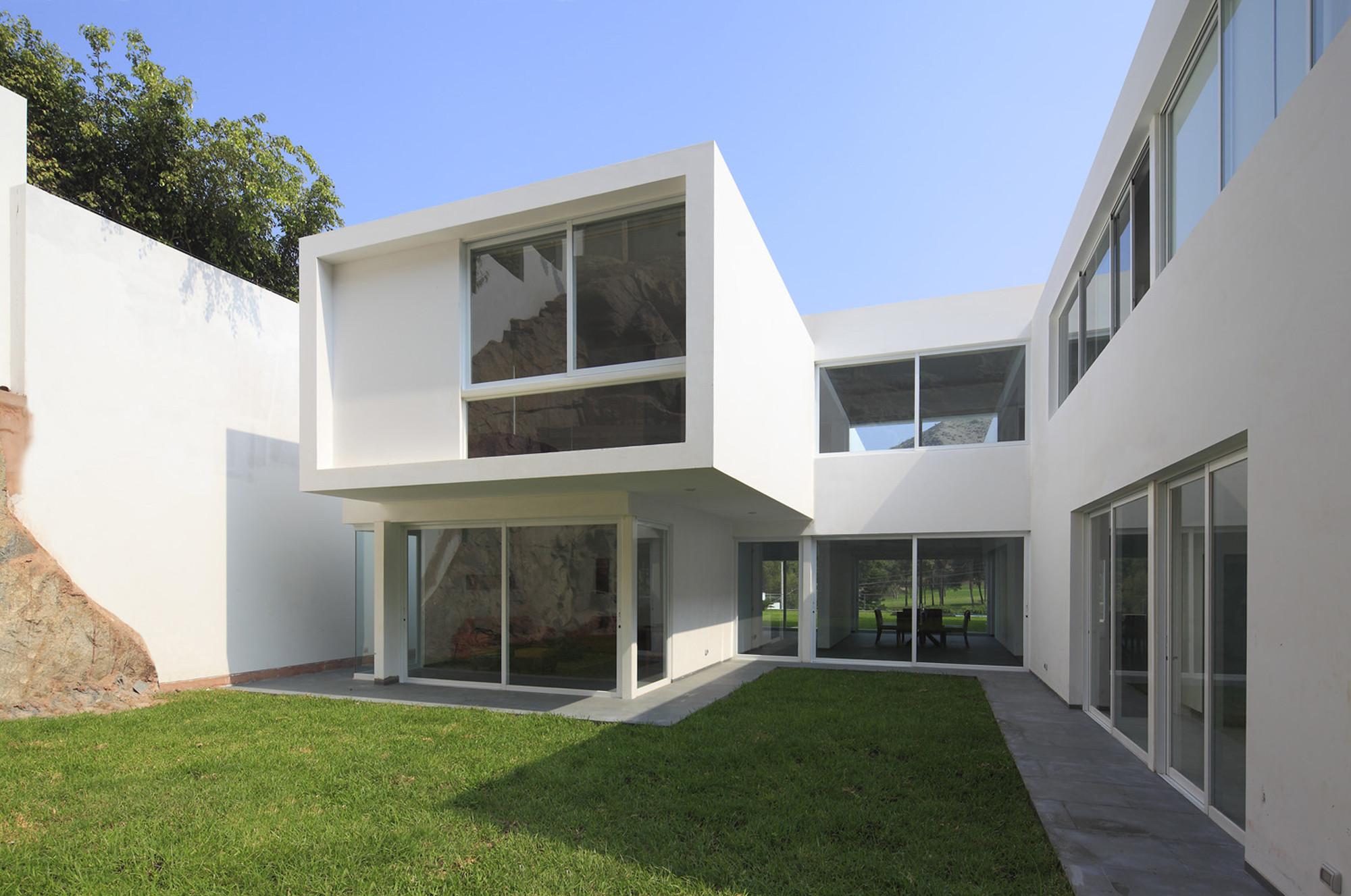 Galeria de casa golf seinfeld arquitectos 7 for Arquitectos para casas