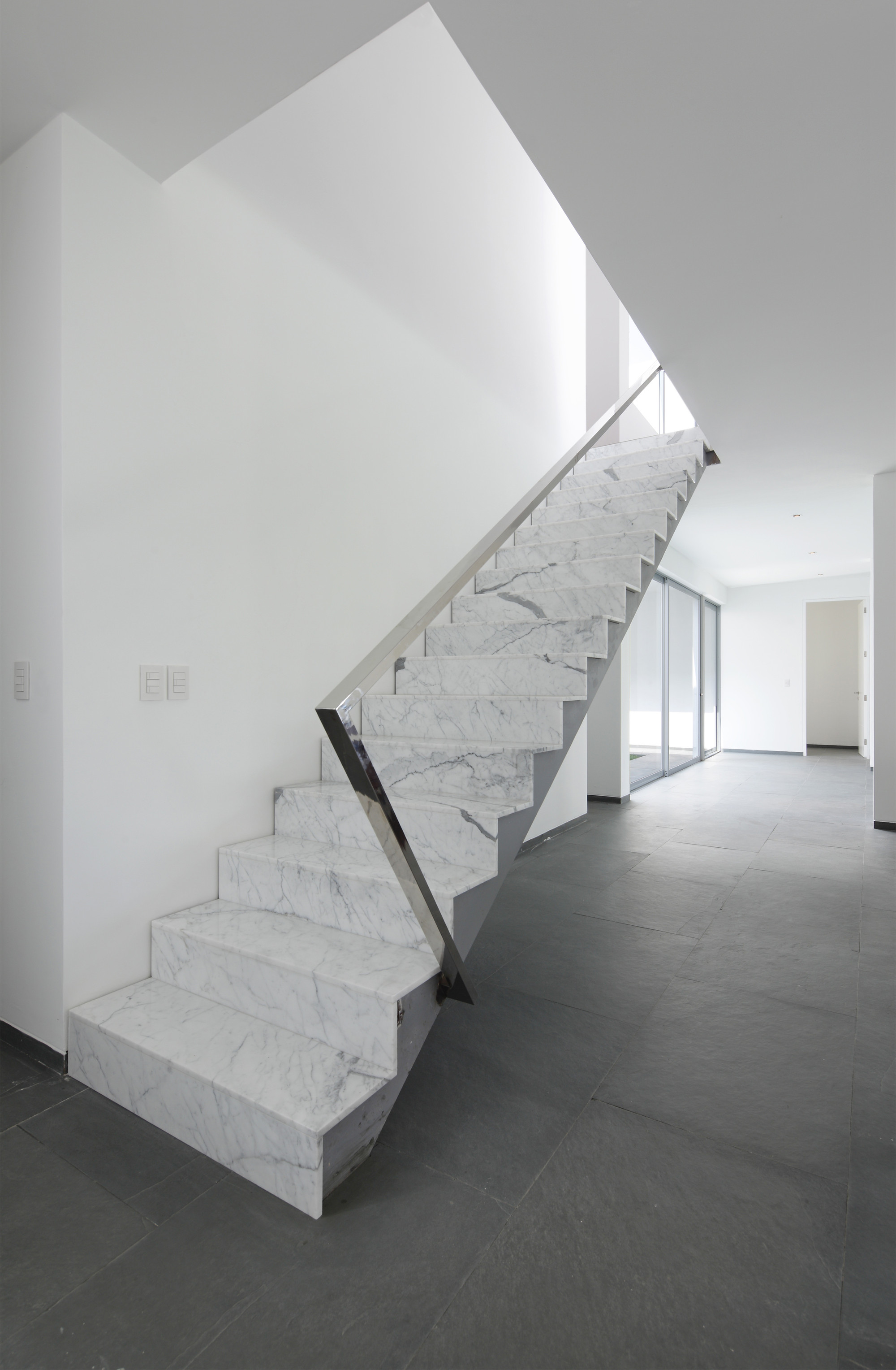 Marble Wall Stairs : Gallery of golf house seinfeld arquitectos