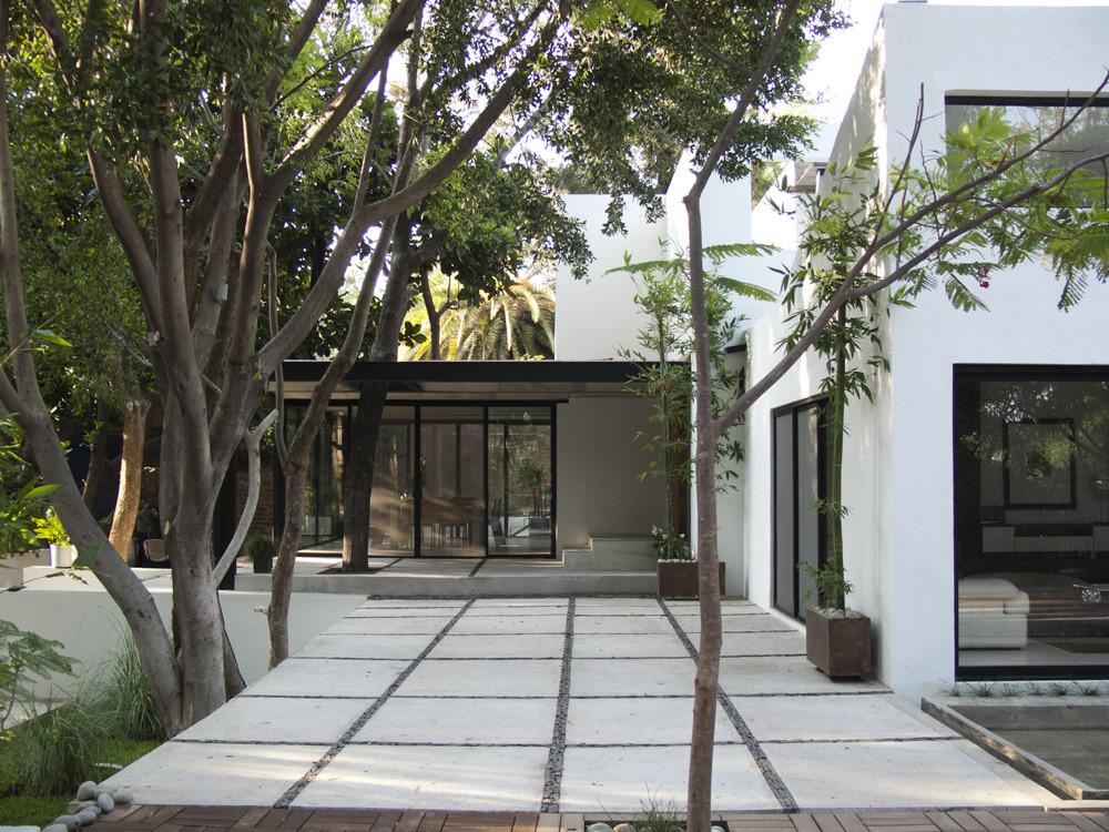 Galer a de casa con 7 patios ars atelier de for Tipos de toldos para patios