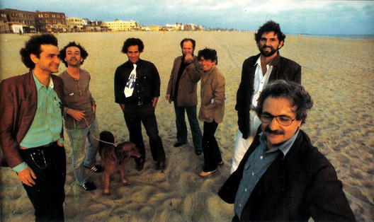 Seven of the architects who participated in the Architecture Gallery, from left to right: Frederick Fisher, Robert Mangurian, Eric Owen Moss, Coy Howard, Craig Hodgetts, Thom Mayne, and Frank Gehry at Venice Beach, 1980 / Photograph by Ave Pildas / Digital Image / Image courtesy of the artist. / © Ave Pildas