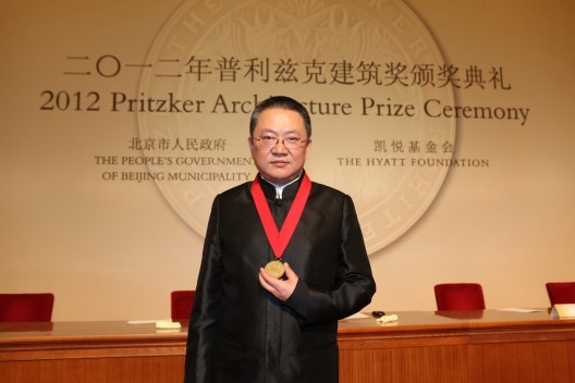 Pritzker's Challenge: Recognition in the Age of Creative Partnerships, Wang Shu receiving his Pritzker Award in 2012. Oddly, his wife and co-partner, Lu Wenyu, was not acknowledged.