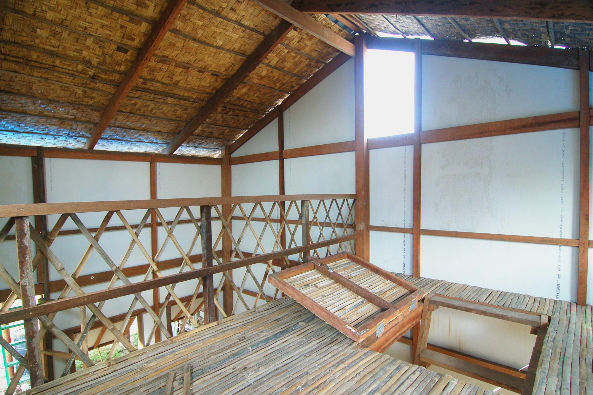 Prototype Housing I / Collective Studio, Bamboo strip loft with hatch door