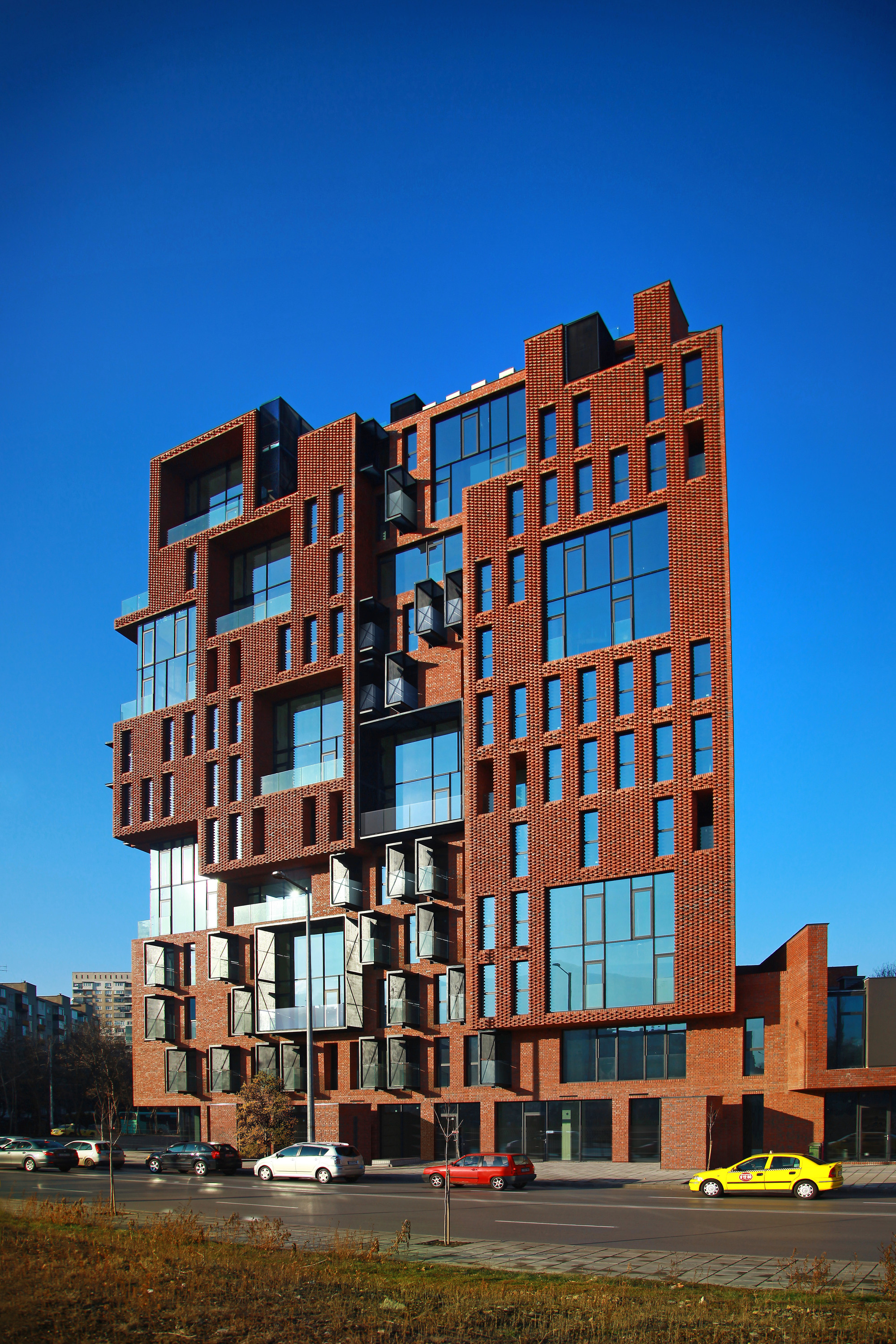 Red Apple Apartment Building / Aedes Studio