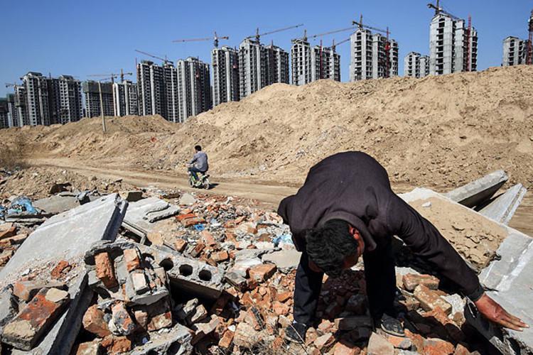 China desaloja camponeses para promover urbanização, © Justin Jin