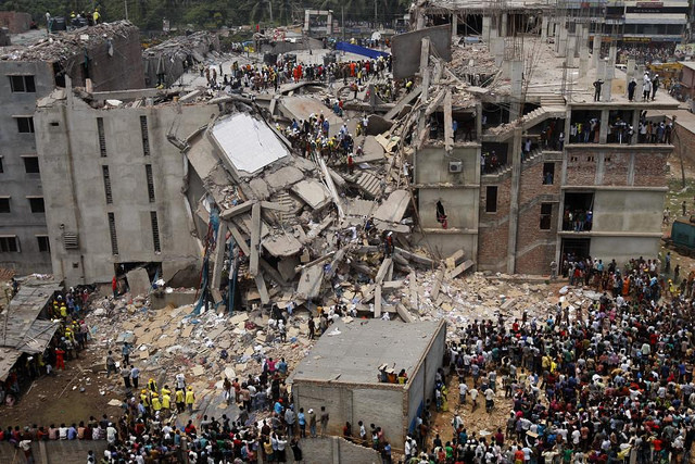 The 13 Most Devastating Architecture Disasters in History, Image of Savar Building Collapse via Flickr © rijans. Used under <a href='https://creativecommons.org/licenses/by-sa/2.0/'>Creative Commons</a>