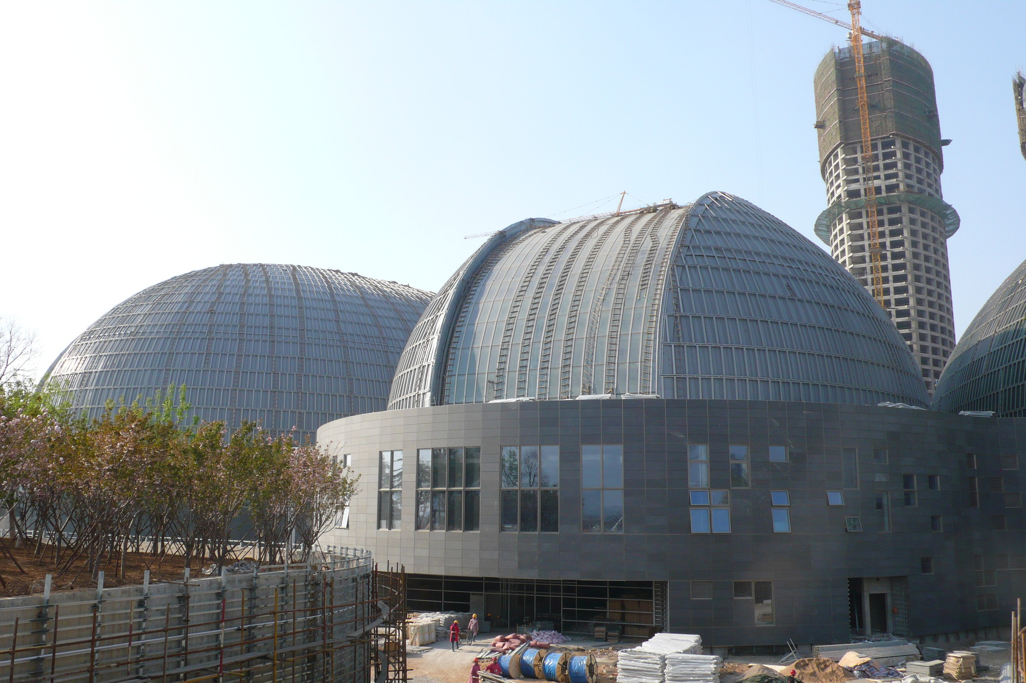 Courtesy Car City >> In Progress: Jinan Cultural centre / Paul Andreu Architecte + Richez Associes + BIAD | ArchDaily