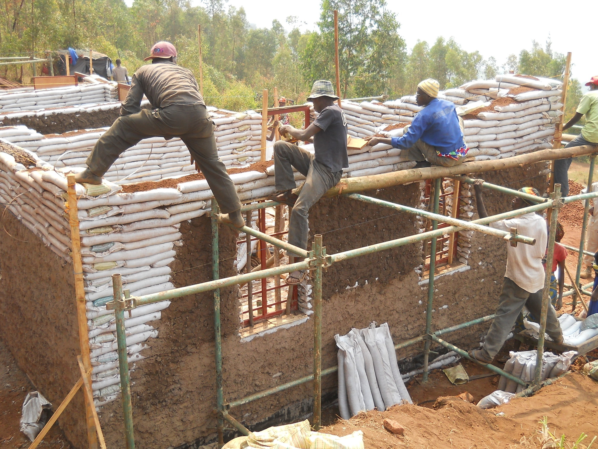 Masoro village project ga collaborative archdaily for Contractors for building houses