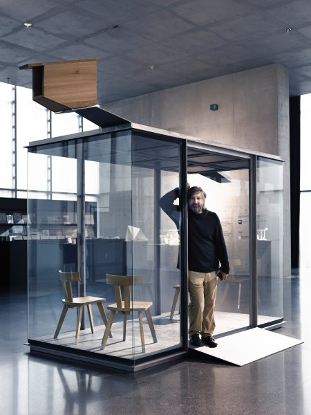 World Famous Architects Design Bus Stops for Tiny Austrian Village, Chilean architect Smiljan Radic standing in his completed bus shelter. Image © Adolf Bereuter / BUS:STOP Krumbach