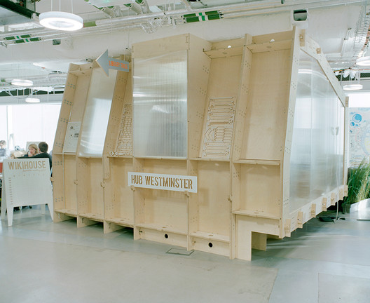 A WikiHouse prototype is used as a meeting area. Image © Kate Peters via Metropolis Magazine
