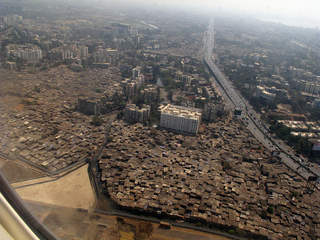 Why Do Slums Persist in Prosperity?, Aerial view over Mumbia. Image © Flickr CC User Cactus Bones