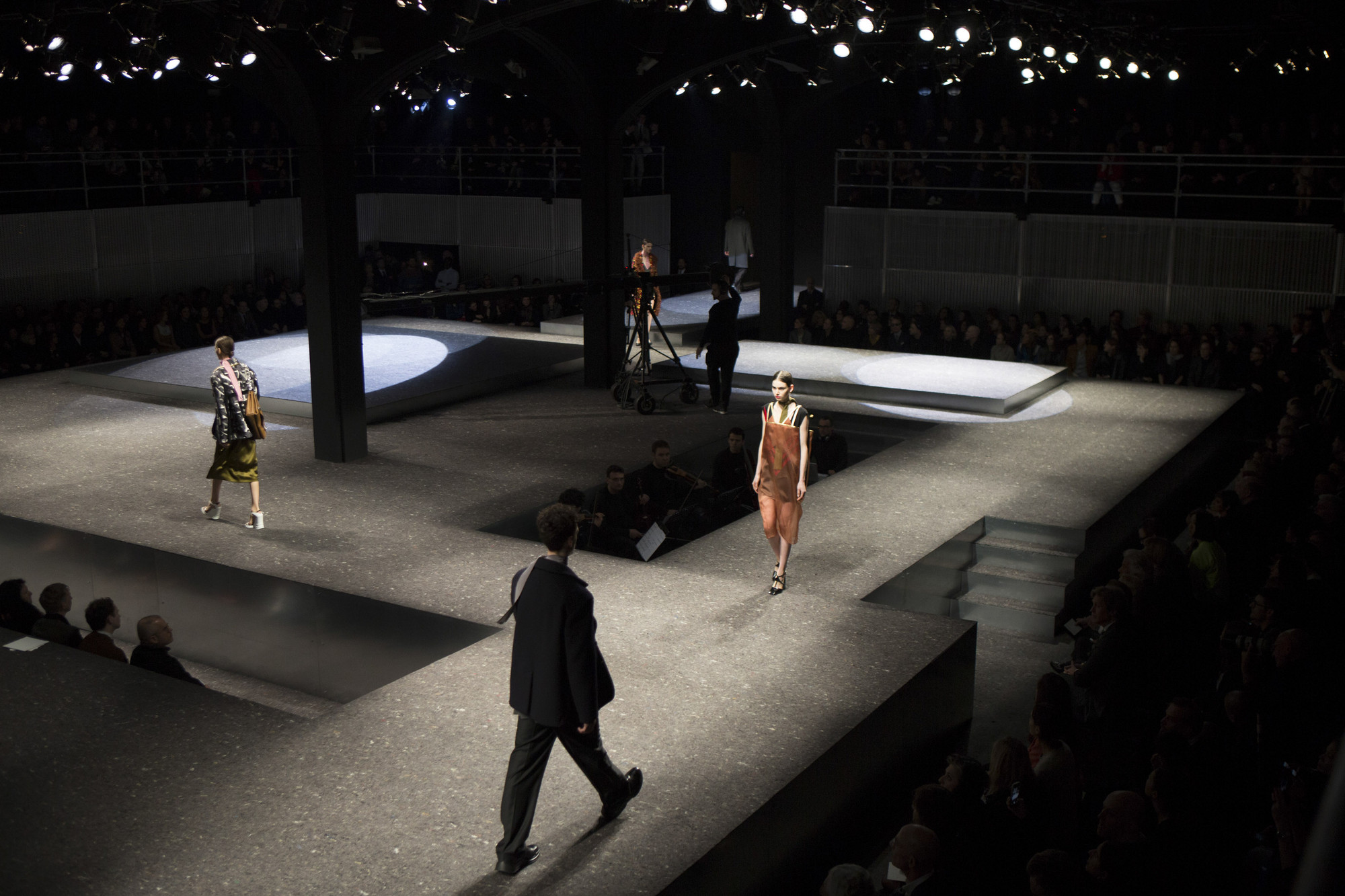 Oma 39 s latest prada catwalk a stage punctuated with - Fashion show stage design architecture plans ...