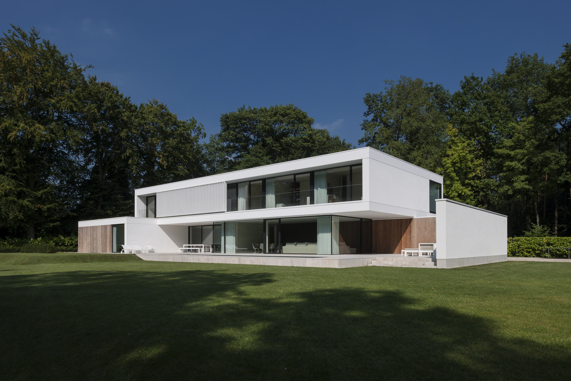 Hs residence cubyc architects archdaily for Cabanes de jardin belgique