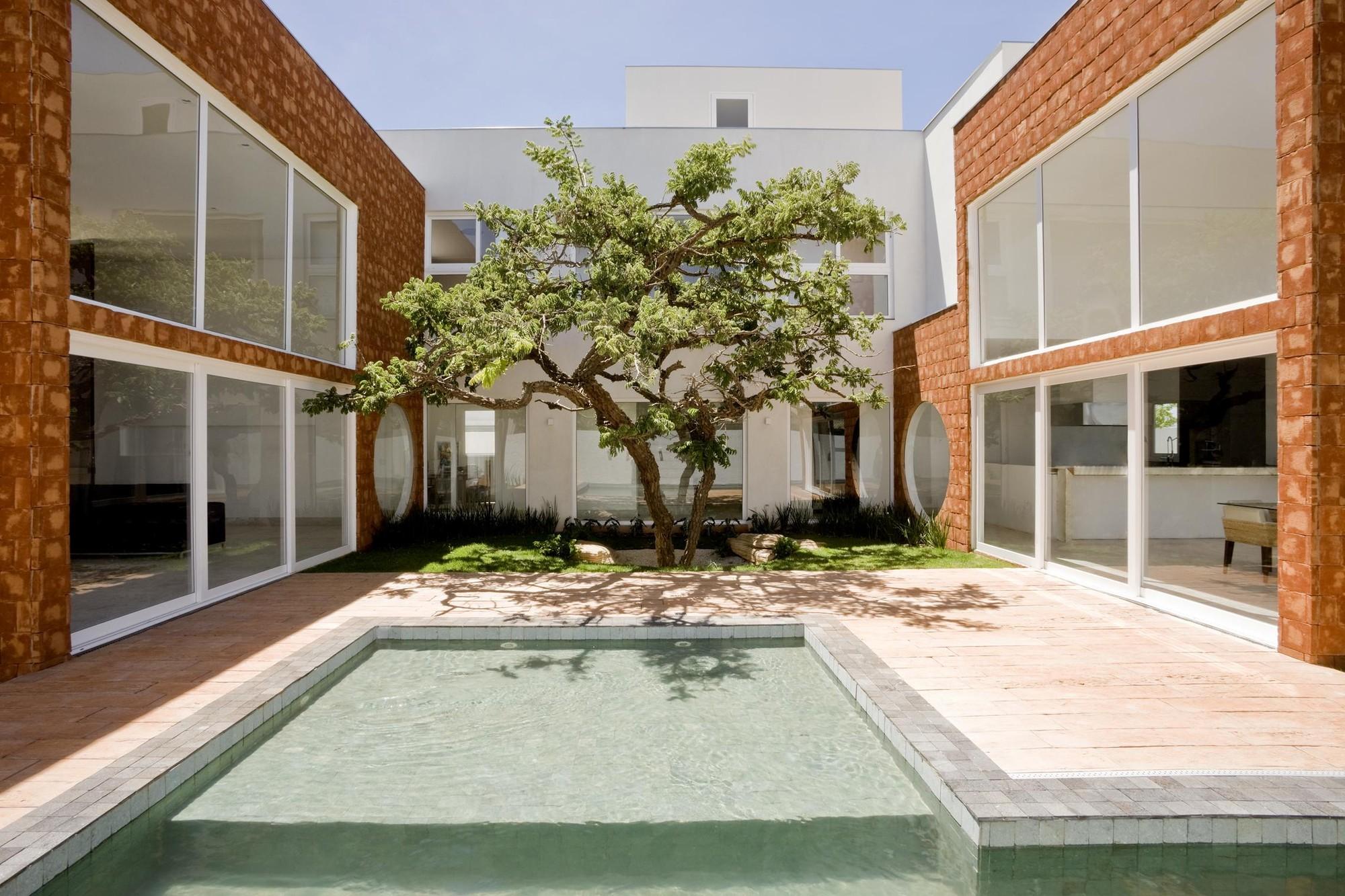 Galeria de casa taquari ney lima 2 for Casa minimalista lima