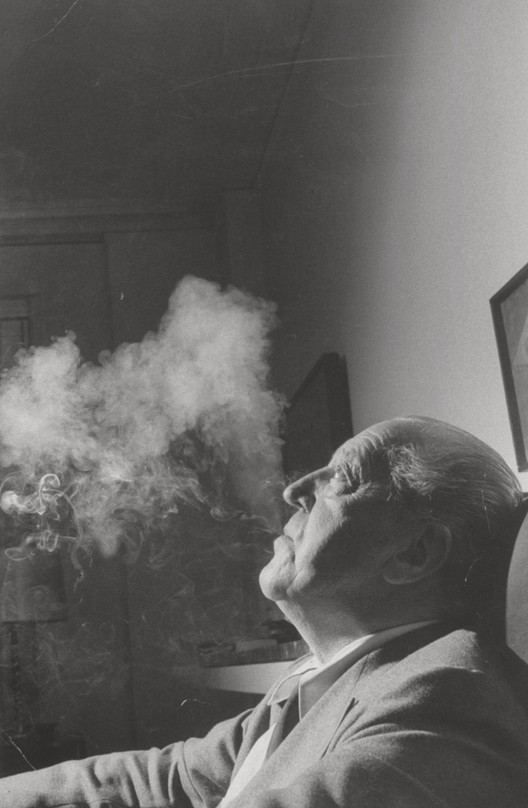Mies, the Modernist Man of Letters, Mies van der Rohe with smoke, 1957; photographed for Life magazine. Image Courtesy of Frank Scherschel/Time & Life Pictures/Getty Images