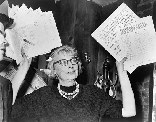 Jane Jacobs, then chairperson of a civic group in Greenwich Village, at a press conference in 1961. Image <a href='https://commons.wikimedia.org/wiki/File:Jane_Jacobs.jpg'>via Wikimedia</a>, photograph by Phil Stanziola (Public Domain)