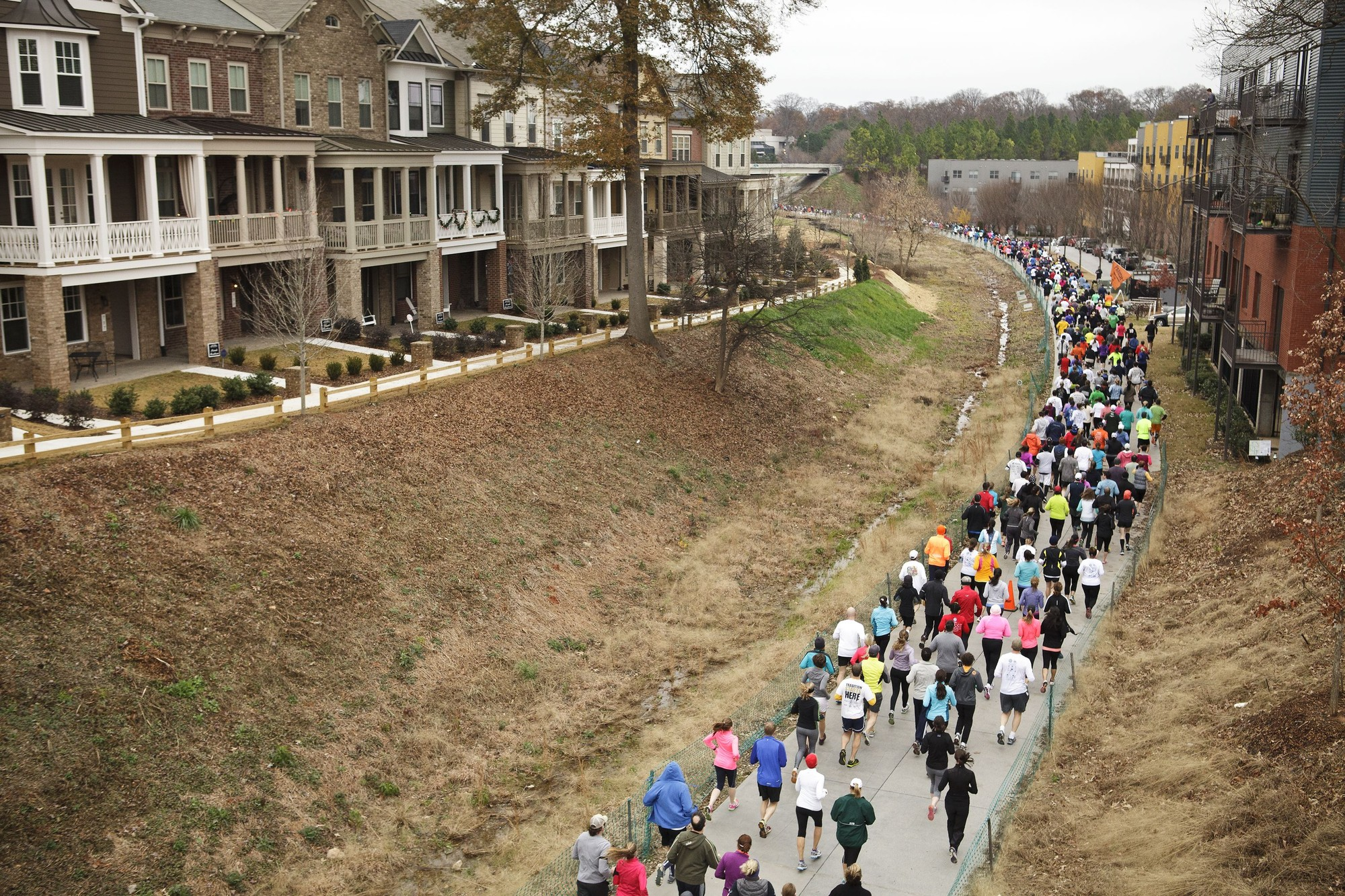 The Atlanta BeltLine: From Student Thesis to Community Mobilizer, A parade passes through the Eastside Trail of the Atlanta BeltLine, completed in October 2012. Image © Christopher T. Martin