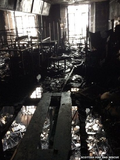 Mackintosh's Iconic Library at Glasgow School of Art Destroyed in Fire, Fire Damage to Glasgow School of Art. Image via BBC © Scottish Fire and Rescue