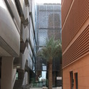 Buildings at Masdar incorporate numerous material and construction strategies for minimizing heat gain including metal screening, terracotta cladding and air-filled wall panels. Image © Tyler Caine