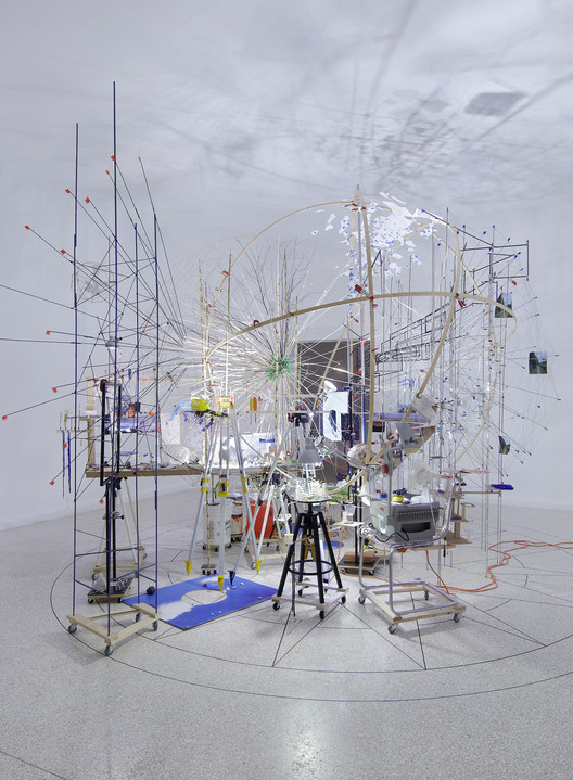 Sarah Sze's 2013 U.S. Venice Biennale Installation Coming Home, Wood, steel, plastic, stone, string, fans, overhead projectors, photograph of rock printed on Tyvek, mixed media at Triple Point (Planetarium), 2013. Image courtesy of Sarah Sze, Tanya Bonakdar Gallery, New York, and Victoria Miro Gallery, London. Photograph by Tom Powel Imaging