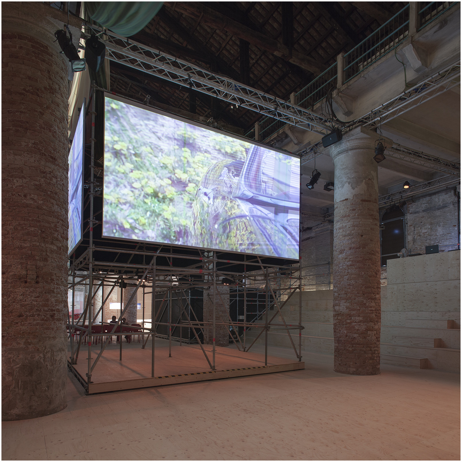 OMA Creates 360-Degree Cinema at the Venice Biennale , The movable module has been placed in the middle of Stage F, displaying one screen for each side. Image © Giorgio De Vecchi