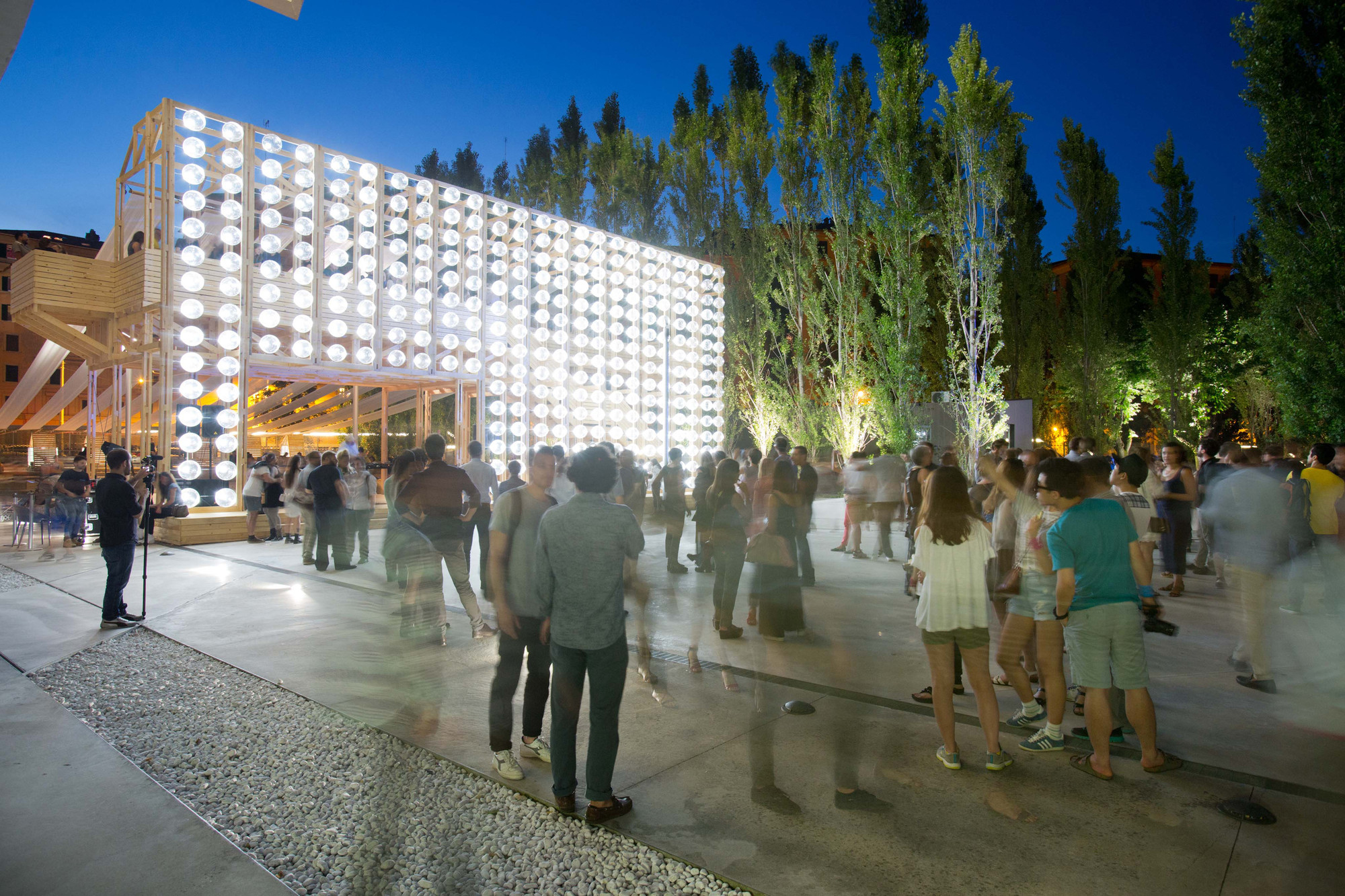Orizzontale Illuminates Outdoor Theater with Recycled Keg Wall at MAXXI