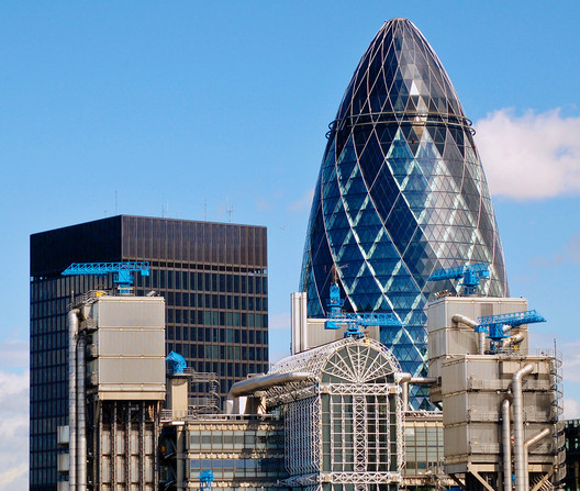 "The ""Gherkin"" in London (background) and the Lloyd's Building (foreground) redefined the skyline through their unorthodox designs. Image © Flickr CC User duncanh1"