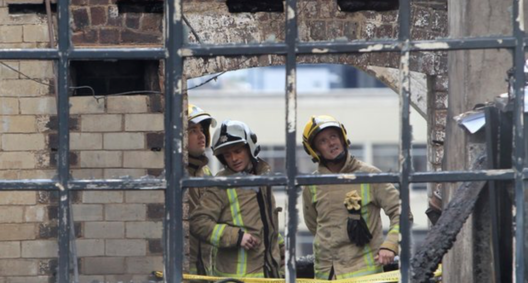 Scottish Fire and Rescue in the aftermath of the fire. Image © Stewart Attwood