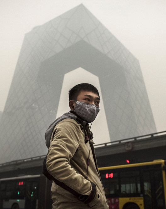 "Reconfiguring Urban Spaces To Compensate For ""Poisonous"" Air, The CCTV Building, Beijing, cloaked by air pollution. Image © Kevin Frayer / Getty Images"