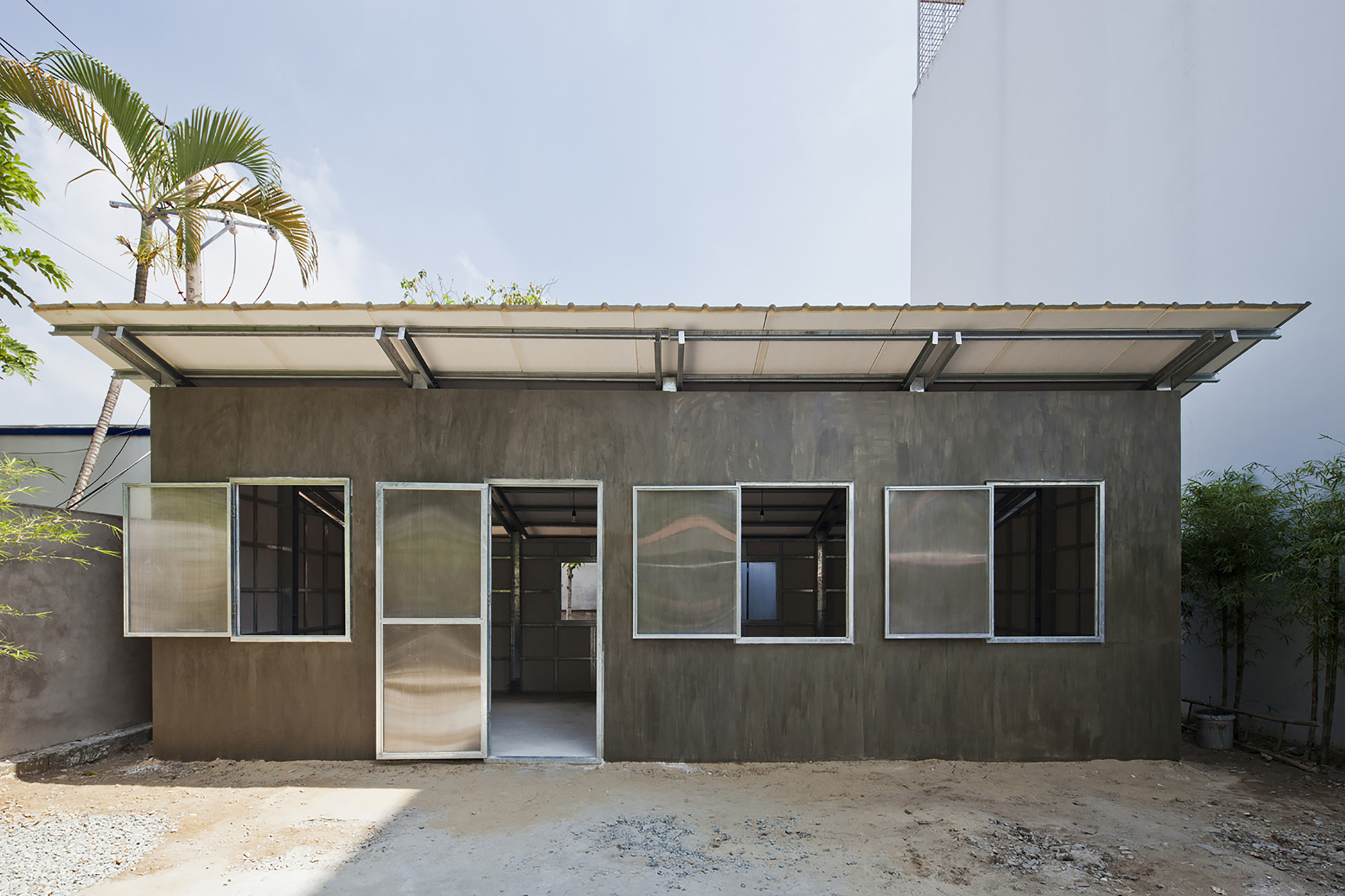 S house 3 vo trong nghia architects archdaily for Low cost building