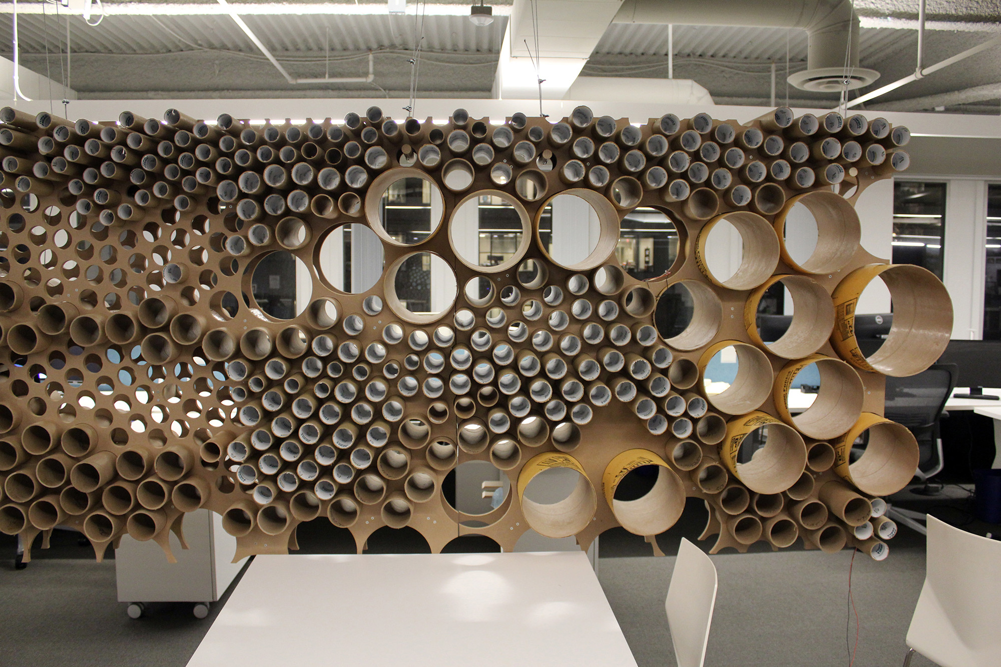 Recycling In Practice: Perkins + Will Finds New Life for Cardboard Tubes,  Phase one view of the 'tube wall'. Image Courtesy of Perkins + Will