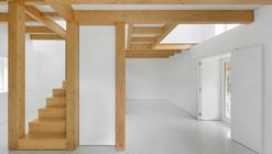 Wood Structure Inside Stone Walls / Corpo Atelier