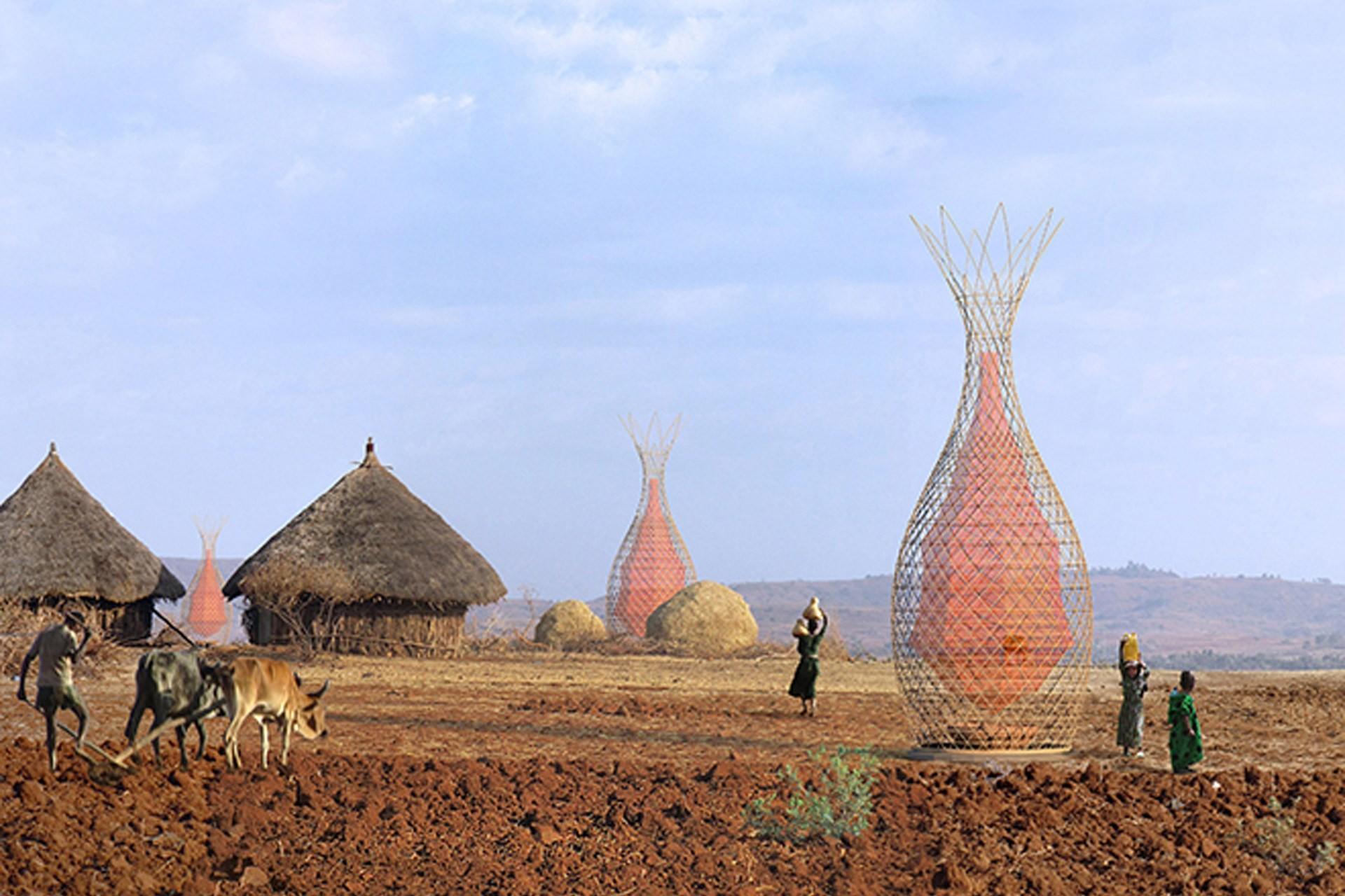 WarkaWater, a estrutura que gera 100 litros de água potável por dia, WarkaWater em área rural da Etiópia. Fonte da imagem: Yogui.co