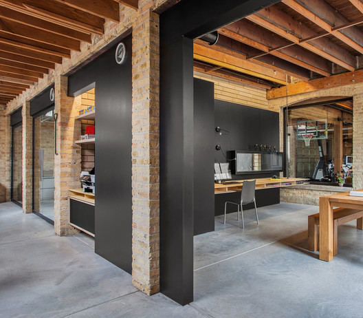 Office Garage By Ultra Architects: Ranquist Development Group Office / Vladimir Radutny